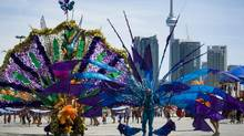 Revelers take part in the 2010 Caribana Parade in Toronto on Saturday, July 31, 2010. (Adrien Veczan/The Canadian Press/Adrien Veczan/The Canadian Press)