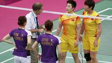 An official (2nd L) speaks to players from China and South Korea during their women's doubles group play stage Group A badminton match during the London 2012 Olympic Games at the Wembley Arena on July 31. Top badminton officials met at Wembley Arena on August 1, 2012 to decide the fate of four women's doubles pairs charged with misconduct for attempting to lose their Olympic matches to secure a more favourable draw. From left: South Korea's Kim Ha-na, Jung Kyung-eun, China's Yu Yang and Wang Xiaoli. (BAZUKI MUHAMMAD/REUTERS)