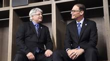 New Toronto Argonauts head coach Marc Trestman, right, and new general manager Jim Popp pose for a photo ahead of a press conference to announce their hirings in Toronto on Tuesday, February 28, 2017. (Frank Gunn/THE CANADIAN PRESS)