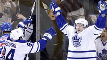 Toronto Maple Leafs forward Nikolai Kulemin celebrates his goal against the New York Rangers with teammate Mikhail Grabovski (L) during the overtime period of their NHL hockey game in Toronto March 27, 2010. REUTERS/Mike Cassese (MIKE CASSESE)