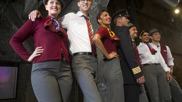 Models show off Air Canada Rouge's newly unveiled uniforms at a news conference in Toronto, May 27, 2013. The discount carrier launches July 1. (Kevin Van Paassen/The Globe and Mail)