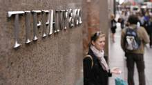 A woman walks out of the Tiffany & Co store on Fifth Avenue in New York. (© Lucas Jackson / Reuters/REUTERS)