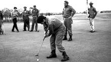 "Ernesto ""Che"" Guevara plays golf as Fidel Castro stands behind him at Colina Villareal in Havana in this undated file picture. Now that Fidel Castro has handed over power to his brother, Raul, Communist Cuba is setting aside any ideological objections and is embracing golf, the most capitalist of sports, in a move to boost tourism. (Prensa Latina/Reuters/Prensa Latina/Reuters)"
