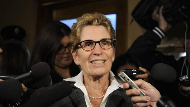 Kathleen Wynne, Minister Of Municipal Affairs And Housing, is scrummed outside a cabinet meeting at Queens Park on Oct. 16, 2012.