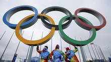 Volunteers stand on a platform displaying the Olympic rings on the Olympic Park as preparations continue for the Sochi 2014 Winter Olympics, January 29, 2014. The opening ceremony for the winter games will be held on February 7. (FABRIZIO BENSCH/REUTERS)