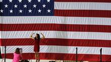 Moody's said it was unlikely it would keep the U.S. triple-A rating with a negative outlook into 2014. (LARRY DOWNING/REUTERS)