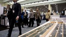 People attend the trade show and investors area at the Prospectors and Developers Association of Canada (PDAC) 2014 convention at the Metro Toronto Convention Centre on Sunday, March 2, 2014. (Matthew Sherwood for The Globe and Mail)