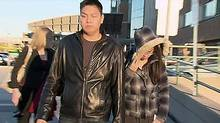 Jennifer Pan, right, leaves Sunnybrook hospital after visiting her father, Hann Pan, on Nov. 11, 2010. (CTV)