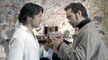 """Robert Downey Jr. (left) and Jude Law as Holmes and Watson in a scene from """"Sherlock Holmes: A Game of Shadows"""" (Warner Bros.)"""