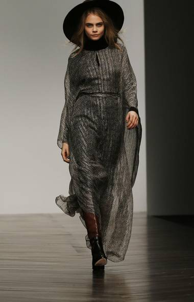 Ubiquitous model-of-the-moment Cara Delevingne opened the Issa show on Saturday night in a gauzy printed full-length caftan that defined the collection's desert bohemian theme. (OLIVIA HARRIS/REUTERS)