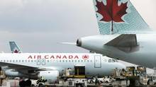 Air Canada planes are pictured at shown at Toronto's Pearson International Airport on May 18, 2014. (MATTHEW SHERWOOD FOR THE GLOBE AND MAIL)