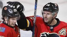 Calgary Flames' Sean Monahan, left, celebrates his goal with Troy Brouwer against the Colorado Avalanche in Calgary on March 27, 2017. (Larry MacDougal/THE CANADIAN PRESS)