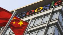 A January 2010 file photo shows a Chinese flag in front of Google offices in Beijing. (LIU JIN/Liu Jin/AFP/Getty Images)