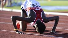 Mohammed Ahmed prays after winning the men's 10,000 metre race at the Canadian Track and Field Olympic Trials in Calgary, Alberta, June 27, 2012. (TODD KOROL/REUTERS)