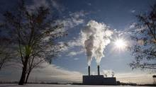 Smoke pours from the stacks at the Portlands Energy Centre in Toronto in 2009. (Frank Gunn/The Canadian Press)