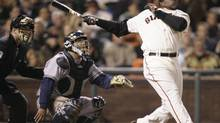 San Francisco Giants' Barry Bonds, right, hits his 761st career home run, a solo effort, off Milwaukee Brewers pitcher Chris Capuano in the fourth inning of a baseball game in San Francisco, Friday, Aug. 24, 2007. (Marcio Jose Sanchez/AP)