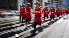 The new disciplinary regime Members of the Royal Canadian Mounted Police march during the Calgary Stampede parade in Calgary, Friday, July 6, 2012. (Jeff McIntosh/THE CANADIAN PRESS)