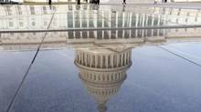 The dome of the U.S. Capitol is reflected on the first day of the 113th Congress in Washington Jan. 3, 2013. (KEVIN LAMARQUE/REUTERS)