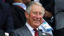 Britain's Prince Charles, center, watches a men's badminton match during the 2012 Summer Olympics, Saturday, July 28, in London. (Saurabh Das/AP)