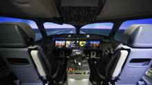 The cockpit in the engineering flight simulator for the C Series CS100 airplane at Bombardier's plant in Mirabel, Que. (Christinne Muschi for The Globe and Mail)