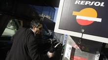 A motorist fills up his car at a Repsol gas station in Madrid November 26, 2008. (SUSANA VERA/REUTERS)