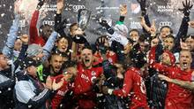 Toronto FC's Michael Bradley and teammates celebrate with the Eastern Conference trophy on Wednesday. (Vaughn Ridley/Getty Images)