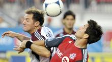 Toronto FC's Andrew Wiedeman heads a ball against Colorado Rapids' Jamie Smith (L) during the second half of their MLS match in Toronto July 18, 2012. (MIKE CASSESE/REUTERS)