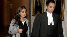 Amanda Rodrigues, widow of former boxing champion Arturo Gatti, leaves court in Montreal with her lawyer, Pierre-Hughes Fortin, on Wednesday. (Ryan Remiorz/The Canadian Press)