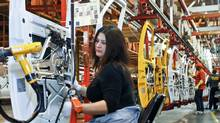 A view of employees working at the General Motors assembly plant in Wentzville, Missouri, in 2012. The rebirth of manufacturing is bypassing Canada, Barrie McKenna writes. (Sarah Conard/Reuters)