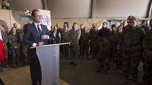 France's President Francois Hollande gives a speech to French soldiers during a visit to a military base in Kapisa where a large number of French combat troops are stationed in Afghanistan on May 25, 2012. (REUTERS)