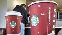 Starbucks rolls out smart phone payments in Canada (Danny Johnston/AP)