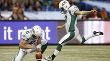Saskatchewan Roughriders kicker Sandro Deangelis kicks a field goal with place holder J.T. O'Sullivan (L) during the first half of their CFL football game against the Toronto Argonauts in Toronto October 8, 2012. (Reuters)