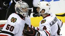 Chicago Blackhawks defenseman Niklas Hjalmarsson (4) celebrates with goalie Corey Crawford (50) after defeating the Los Angeles Kings in Game 4 of the NHL Western Conference final hockey playoff in Los Angeles, California, June 6, 2013. (Reuters)