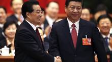 China's newly elected President and chairman of the Central Military Commission Xi Jinping, right, shakes hands with his predecessor Hu Jintao during the fourth plenary meeting of the first session of the 12th National People's Congress in Beijing, March 14, 2013. (CHINA DAILY/REUTERS)