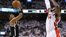 Brooklyn Nets forward Paul Pierce hits a three-pointer against Toronto Raptors forward Patrick Patterson in game one during the first round of the 2014 NBA Playoffs at Air Canada Centre. (USA TODAY Sports)