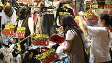A hike in Japan's consumption tax has been opposed on the grounds that it could damage an already weak economy. (ISSEI KATO/ISSEI KATO/REUTERS)