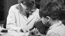A nurse takes a blood sample from a boy at the Indian School, Port Alberni, B.C., in 1948, during the time when nutritional experiments were being conducted on students there and five other residential schools. (HO/THE CANADIAN PRESS)