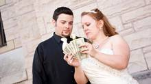 Holding the Money (Christa Brunt/Getty Images/iStockphoto)
