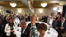 Elder Walter Cooke holds an eagle feather as he conducts the opening prayer for premiers from across the country and National Aboriginal Organization leaders during a meeting in Niagara-on-the-Lake, Ont., on July 24, 2013. (AARON LYNETT/THE CANADIAN PRESS)