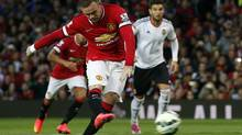 Manchester United's Wayne Rooney shoots but fails to score a penalty against Valencia during their friendly soccer match at Old Trafford in Manchester, England Aug. 12. (ANDREW YATES/REUTERS)