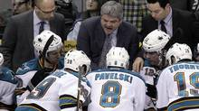 San Jose Sharks head coach Todd McLellan, centre, talks to his players during the third period of an NHL hockey game against the Los Angeles Kings in Los Angeles, Tuesday, March 20, 2012. (Jae C. Hong/Associated Press)