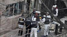 Police officers gather near the side entrance of the U.S. Embassy in Ankara, after a suspected suicide bomber detonated an explosive device on Friday Feb. 1, 2013. (Associated Press)