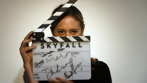 "A worker holds a clapperboard from the film ""Skyfall"" during a media preview of ""50 Years of James Bond – the Auction"" at Christie's in London on Thursday. (Reuters)"