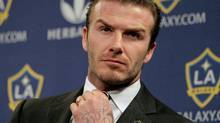 Los Angeles Galaxy's David Beckham fixes his tie during a soccer news conference in Los Angeles, Thursday, Jan. 19, 2012. (Jae C. Hong/AP)