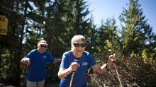 Esther Kafer, 84, and Martin Kafer, 85, make their way up the Grouse Grind in North Vancouver on Sept. 6, 2012. They're planning to climb Mt. Kilimanjaro. (Rafal Gerszak for the Globe and Mail)