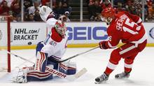 Detroit Red Wings center Riley Sheahan (15) scores on Montreal Canadiens goalie Ben Scrivens (40) in the second period of an NHL hockey game, Thursday, March 24, 2016 in Detroit. (Paul Sancya/AP)
