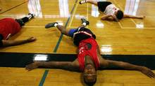 Prospects strech during a training camp at Humber College Lakeshore Campus in preparation for the National Basketball League of Canada's draft this weekend in Toronto, Ont., on August 16, 2011. (Michelle Siu / The Globe and Mail) (Michelle Siu/The Globe and Mail)