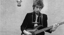 Bob Dylan playing bass in a recording studio, 1965 (Sony Music Entertainment)