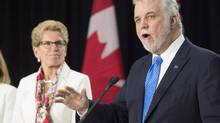 Ontario Premier Kathleen Wynne invited Quebec Premier Philippe Couillard to make the speech to highlight the increasingly close relationship between the two provinces. (Frank Gunn/The Canadian Press)
