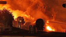 First responders fight burning trains after a train derailment and explosion in Lac-Megantic, Quebec early July 6, 2013 in this picture provided by the Transportation Safety Board of Canada. (HANDOUT/REUTERS)